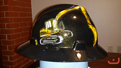 Construction hard hat with heavy equipment
