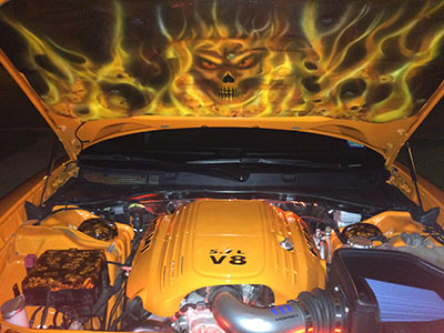 Custom skull and flames on hood liner