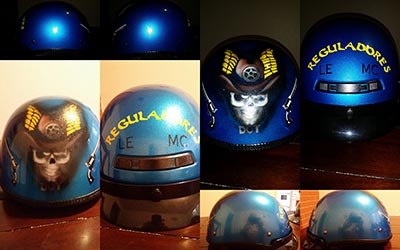 regladoras custom helmet painted blue with skull and mc logo